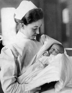 Lucien P. Smith Jr. in the arms of a nurse, November 1912. Smith's mother, Eloise Hughes Smith, was pregnant with him, returning from her honeymoon on the Titanic. Her husband, Lucien P. Smith Sr., did not survive. Eloise later married a fellow Titanic survivor, Robert P. Daniel.