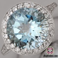 Deco Aquamarine Engagement Ring with a 4 carat center stone! I love this ring...