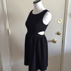 Black Skater Dress with Waist Cutouts Black knit dress with cutout detail at waist.  Invisible zipper closure in back. Forever 21 Dresses