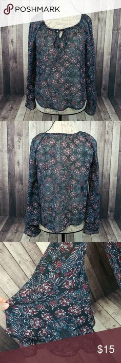 "Lily White sheer bell sleeved top EUC Lily White sheer floral long bell sleeved top. Ties at neckline. 100% polyester. Lay flat measurements: approximately 18"" pit to pit, 23"" long. Lily White Tops Blouses"