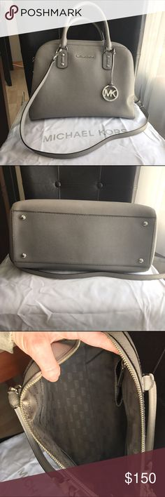 Large Gray Authentic Micheal Kors Handbag EUC. Gray and silver 13 inch handbag. This is a beautiful bag! Comes with cross-body strap and dust bag. Michael Kors Bags Crossbody Bags