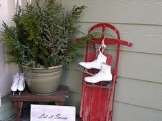Christmas porch decorating with greens, a primitive bench, skates and an antique sled. Where's the snow? Primitive Christmas, Christmas Porch, Noel Christmas, Outdoor Christmas Decorations, Country Christmas, All Things Christmas, Winter Christmas, Vintage Christmas, Christmas Crafts