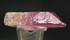 Spodumene (variety kunzite). ~Doubly terminated crystal, a floater, with excellent color, luster and transparency and abundant figures of growth on the main faces. On the collection record it's noted as acquired in Zürich from Arthur Sulzbach, September 1961. Minas Gerais  Brazil