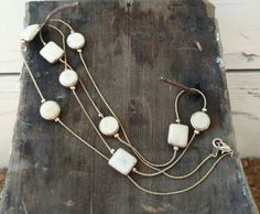 Check out this item in my Etsy shop https://www.etsy.com/listing/290433637/retro-white-enamel-necklace-elegant