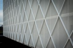 Diamond-patterned Fencing Clads Facade Of Office And Workshop By CAAN Architects | Architecture