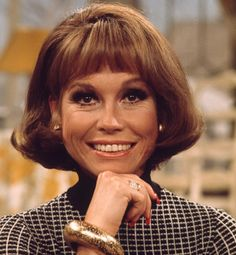 The Mary Tyler Moore Show  Ah, Mary Richards — the single girl's '70s icon. We loved that Mary was always pretty and professional, which wasn't always the case back then. MTM and her alter ego convinced us that we were indeed going to make it after all ... with really great hair to boot.