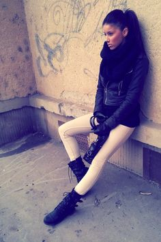 So darn cool! Beige skinnies, leather jacket, black infinity scarf, rocker boots.