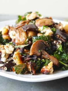 A delicious warm salad with roasted kale, mushrroms, and eggplant, tangy goat cheese, walnut and balsamic vinaigrette. It's the perfect side dish for cooler weather. (gluten-free, vegetarian) via livelytable.com