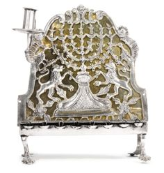 A POLISH PARCEL-GILT SILVER HANUKAH LAMP | Lot | Sotheby's. Some1 says this represents Dave Beckmann & my Polish families coming together.(Prussia became a part of Poland). Dave's Grandfather was Polish Bolshevik (Grandmother was Anastasia Romanov). Personally I don't know. Dave, please confirm.