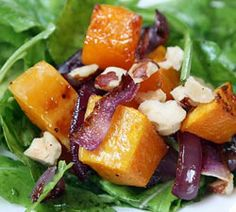 Nutritious and beautiful, this hearty salad combines the favorite fall flavors in sweet butternut squash with piquant red onion and roasted hazelnuts. Add sliced turkey or chicken sausage or cubes of sautéed tofu to make this a complete meal.