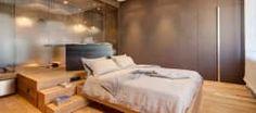 Luce ed atmosfera per l'ambiente in cui si inizia e si termina la giornata: Camera da letto in stile in stile Minimalista di Andrea Bella Concept