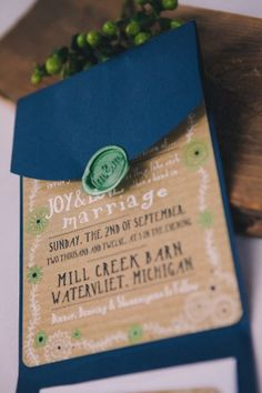 Love this invitation - burlap/tan and navy with mint accents.