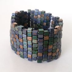 Our beaded cuff tutorial is going to show you how to make cuff bracelets with beads. Compared with all the other beaded cuff bracelets, it. Beaded Cuff Bracelet, Seed Bead Bracelets, Beaded Jewelry, Cuff Bracelets, Diy Bracelet, Stone Bracelet, Stretch Bracelets, Jewellery, Handmade Jewelry Tutorials