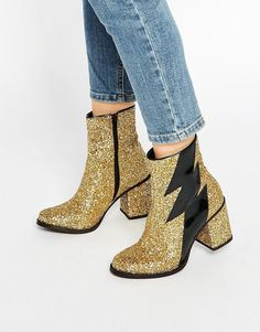 House of Holland Thunder Gold Glitter Heeled Ankle Boots at asos.com. oh lordy, these gold glitter boots are somewhere between david bowie and abba! obsessed with them! perfect for parties, clubs and shopping! boots to make your friends jealous!