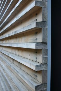 Jackson Family Retreat with exterior wood slats are utilitarian in the way they are connected to the substrate — countersunk screws — but note the care in angling the top of the projecting pieces, so water sheds off the wood | Fougeron Architecture FAIA