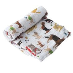 Buy Little Unicorn - Single Cotton Muslin Swaddle - Woof online and save! Beautiful single Muslin Wraps from Little Unicorn featuring on trend designs, are great for swaddling, nursing, cuddling, and more.