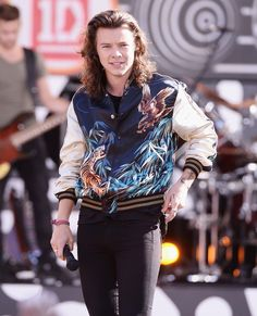 Style Watch: One Direction Performs on Good Morning  America Harry Styles performs in a bomber jacket from Saint Laurent's spring-summer 2016 menswear collection.