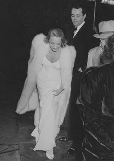 The arrival of Marlene Dietrich and Henry Fonda at some kind of Hollywood event, probably 1942 or 43.
