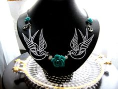 Teal Roses and Tattoo Swallow Necklace.