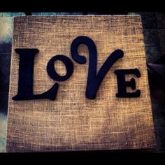 Used canvas, spray painted it black, burlap stapled on. Then painted wooden letters black and hot glued them on! :)