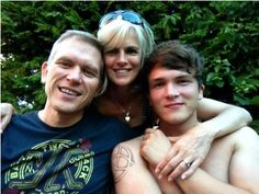 Josh and his parents :) why is doesn't he have a shirt on.... not that I'm complaining :)