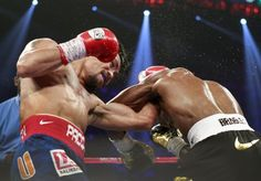 WBO welterweight champion Manny Pacquiao of the Philippines connects on Timothy Bradley Jr. of the U.S. during their title fight at the MGM Grand Garden Arena in Las Vegas, Nevada
