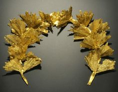 Greek Gold Oak Leaf Funerary Wreath, c. Century BC A funerary wreath in gold foil comprising twelve delicate oak leaf sprigs on a c-shaped fillet with central cluster; professionally restored and mounted Greek Jewelry, Old Jewelry, Jewelry Art, Antique Jewelry, Jewlery, Roman Artifacts, Ancient Artifacts, Hellenistic Period, Greek Crown