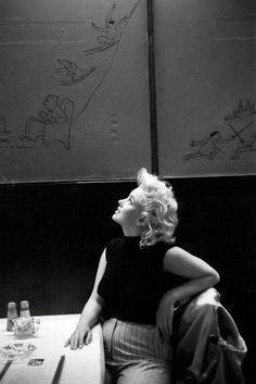 in Restaurant Costello in New York, March 1955