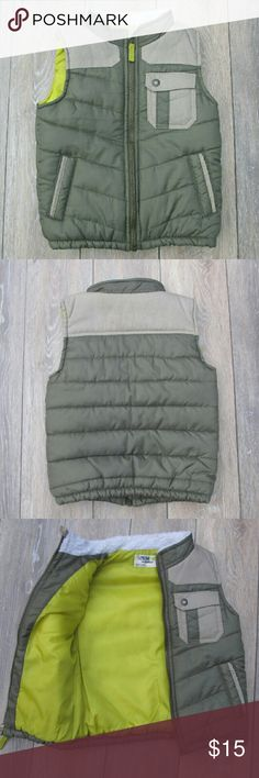 Genuine Kids Oshkosh Boys Khaki Green Zip Up Vest Genuine kids oshkosh boys outerwear vest.   *Size: 5T Zip up front with 2 lower side pockets and 1 left chest pocket. Has a zipper stopper. Khaki green in color with beige accents and a fleece color to keep warm!  No flaws. Osh Kosh Jackets & Coats Vests