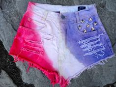 Hand upcycled jeans shorts by 16-year old designer Sophia Scanlan for Stubborn Jeans. Red, white and blue with star studs.