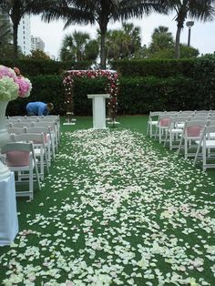 Love out pink and white ceremony set-up