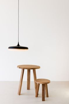 """Inspired by a droplet of water frozen in time the """"Droplet Pendant"""" mimics the beauty and elegance of fluid form. Available in black or white aluminum spun top, American oak or black walnut ring. Appropriate  for both ambient and task lighting. Designed By Viktor Legin"""