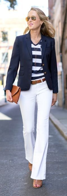 70s fashion revival mid rise high waisted white flare leg jeans, brown braided belt, brown peep toe bootie mules, navy and white wide stripe v-neck burberry t-shirt tee with pocket, navy blazer
