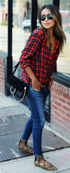 Julie Sarinana keeps it casual in a plaid shirt, skinny jeans, and funky leopard print pumps.   Jeans: AG Jeans, Shirt: Equipment, Shoes: Loeffler Randall.