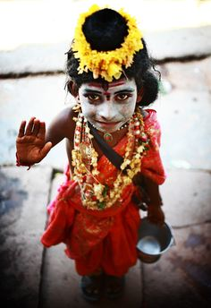 A child dressed as Hindu God Shiva looks on during festival.  Varanasi in India