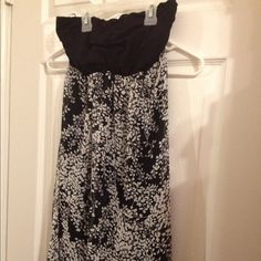 Express black and white strapless top This is a beautiful black and white xs strapless top. It was only worn once and is in great condition. It has a black liner under the sheer patterned area. Express Tops