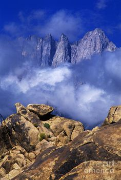 Mount Whitney, California - Low clouds frame mount whitney and the sierras during a clearing summer storm in the Alabama Hills blm lands (Bureau of Land Management) in the eastern Sierras near Lone Pine, California