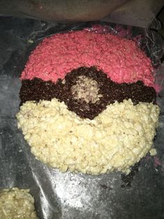 Pokémon rice krispy treat. I followed a regular rice krispy treat recipe... I separated the melted marshmallows so I could add red dye for one, keep one white, and to make black I added red, blue, and green dye. Then I followed the rest of the recipe and shaped it into a Pokémon ball. This was funny and not that difficult.
