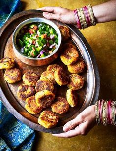 Traditionally cooked in Indian households as a snack, these potato cakes are packed with warming spice and served with a fresh, crunchy kachumber salad. Using sweet potato keeps them lighter.