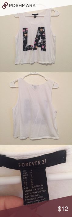 Floral LA cropped tank top A floral LA cropped tank top in a size small from forever 21. Gently worn but still in great condition! Forever 21 Tops Tank Tops