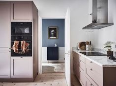 Flos Glo Ball – Coco Lapine 'Anyone Home?' print – TON chair 18 – Friends and Founders mirror – Gubi Wall lamp – Vipp Black pedal bin – H&M Home linen bedding I think this is a very nice example of