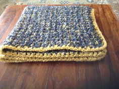 Crocheted blanket using Homespun, in three colours and edged in gold for my husband. He needed a blanket from home when he is working out of town. Sz P hook and triple strands of sc for the entire piece.