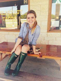 Striped dress, chambray shirt, and green Hunter rain boots.