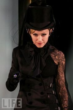 """Madonna displays a split personality at the first London concert for her """"Confessions"""" tour in 2006."""
