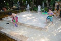 Splash Pad with wading pool for the backyard --- low up-keep, safer than a pool, and has a small footprint. Can DIY with a kit or contract it... You control the jets to spray anywhere from 12 inches to 12 feet.
