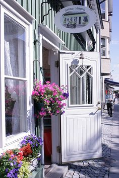 love the door and window boxes - would be so cute for our home