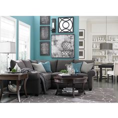 I love this L-Shaped sectional with durable fabric and round coffee table from www.bassettfurniture.com . This is a wonderful color for a room!