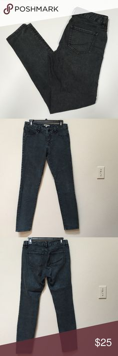 """CAbi skinny jeans This is a pair of gently worn CAbi skinny jeans. No holes or stains. The color is faded black or dark gray. The size is 4. Inseam is 31"""". The style number is 966. Fabric includes 81% cotton, 18% polyester, and 1% spandex. CAbi Jeans Skinny"""