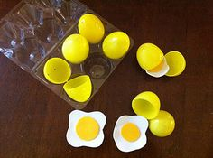 """Awesome play food. Plastic Easter eggs and felt yolks. They will love to """"crack"""" these."""