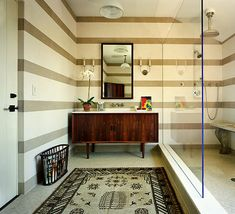 Great Idea - convert an old credenza into a bathroom vanity.  This is midcentury modern...one of my favorite periods in furniture and architectural design.